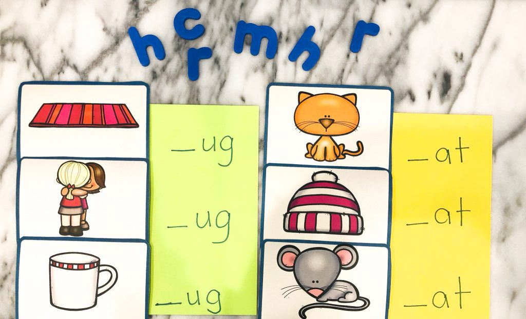 picture cards, magnetic letters, representing an activity for word families