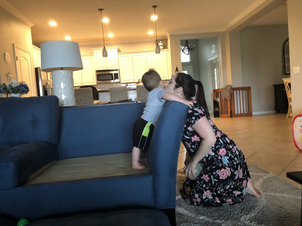 mom and toddler boy playing on couch
